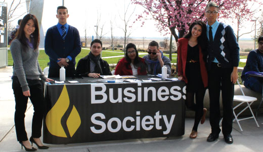 Students posing around UC Merced Business Society booth