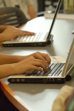 Students typing on computer