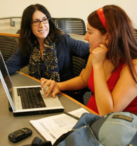 Professor Teenie Matlock works with a student.